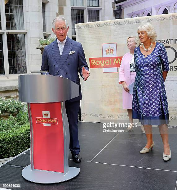 Prince Charles Prince of Wales gives a speech as CEO of Royal Mail Moya Breene and Camilla Duchess of Cornwall looks on as he attends a reception to...