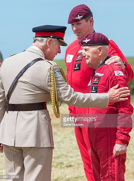 Prince Charles, Prince of Wales greets 88 year old D-Day Veteran Jock Hutton after he completed a parachute jump just outside Rainville during D-Day...