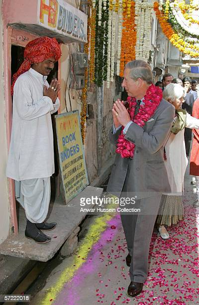 Prince Charles Prince of Wales greets a shopkeeper as he takes a walking tour of the Old City on the final day of a 12 day official tour visiting...