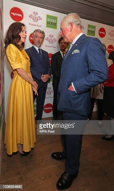 Prince Charles, Prince of Wales greets Anna Friel and Pierce Brosnan as he attends the Prince's Trust And TK Maxx & Homesense Awards at London...