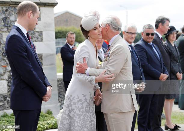 Prince Charles Prince of Wales greets Catherine Duchess of Cambridge and Prince William Duke of Cambridge during a ceremony at the Commonwealth War...