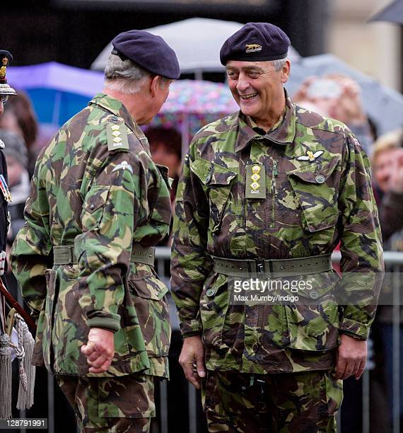 Prince Charles, Prince of Wales greets Gerald Grosvenor, The Duke of Westminster before taking the salute during the parade as The Queen's Own...