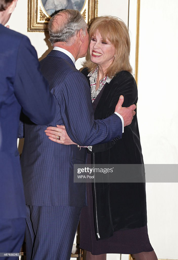 Prince Charles, Prince of Wales greets Joanna Lumley during a reception to launch 'Travels To My Elephant' at Clarence House on March 26, 2015 in London, England. In November 2015 a fleet of thirty rickshaws will journey 500km across Madhya Pradesh, India, in a race to save Asias elephants from extinction.