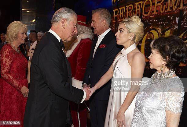Prince Charles Prince of Wales greets Lady Gaga during the Royal Variety Performance at Eventim Apollo on December 6 2016 in London England