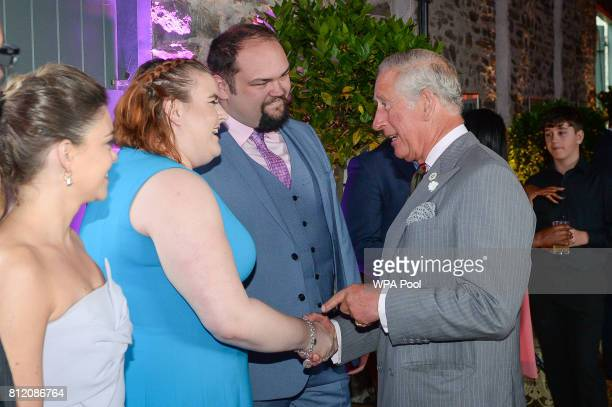 Prince Charles Prince of Wales greets performer Becca Barrett at the barn at his Welsh home near Llandovery where he is hosting a music and drama...