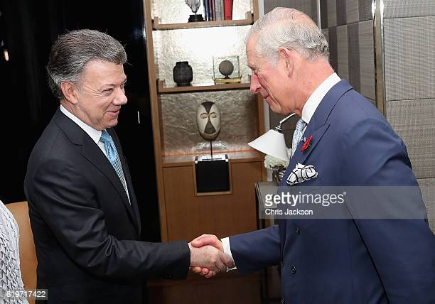 Prince Charles Prince of Wales greets President of Colombia Juan Manuel Santos and his wife María Clemencia Rodríguez Múnera in their suite at the...