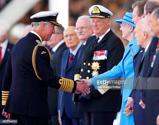 Prince Charles Prince of Wales greets Queen Margrethe of Denmark as they attend the International Ceremony at Sword Beach to commemorate the 70th...