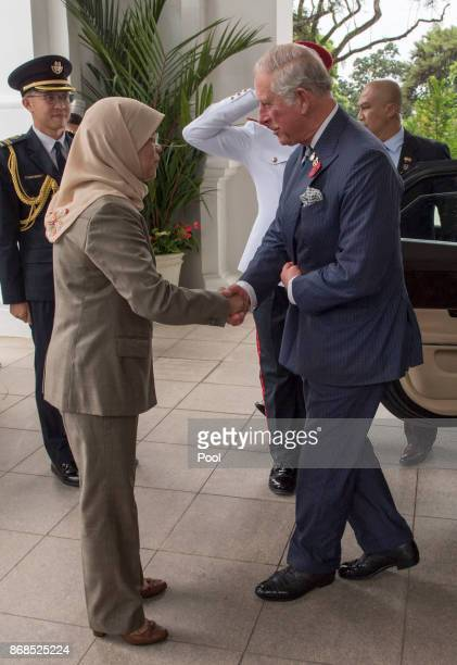 Prince Charles Prince of Wales greets Singapore President Halimah Yacob as he visits the Istana Presidential Palace on October 31 2017 in Singapore...
