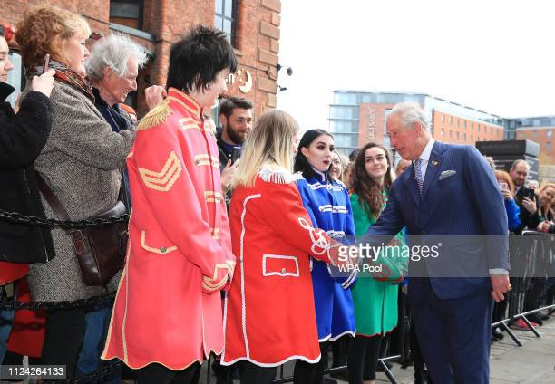 Prince Charles Prince of Wales greets wellwishers during a visit to Royal Albert Dock on February 12 2019 in Liverpool England The Dock which was...