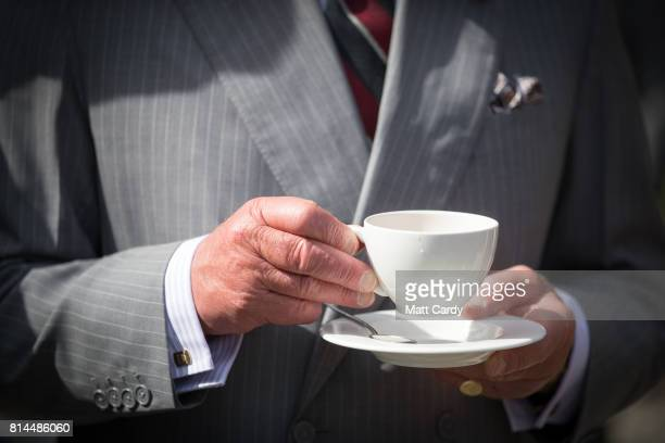 Prince Charles Prince of Wales has a cup of tea as he takes a tour of the gardens at Plas Cadnant Hidden Gardens during The Prince of Wales' annual...