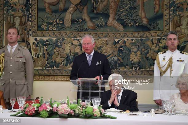 Prince Charles Prince of Wales holds a speech while Camilla Duchess of Cornwall and the President of Greece Prokopis Pavlopoulos react during an...