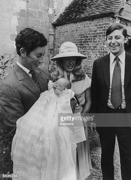 Prince Charles Prince of Wales holds his 9 weekold godson Charles George Barrington Tryon after the boy's baptism at the Church of St Andrews...