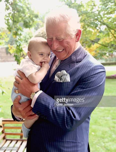 Prince Charles Prince of Wales holds Prince Louis of Cambridge after a family portrait photoshoot in the gardens of Clarence House on September 5...
