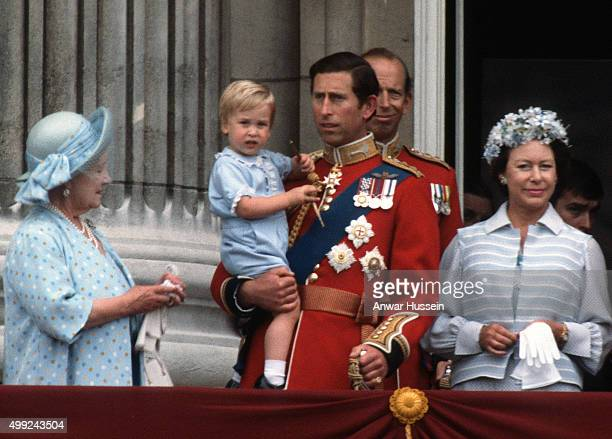Prince Charles Prince of Wales holds young Prince William on the balcony of Buckingham Palace following the Trooping the Colour ceremony on June 16...