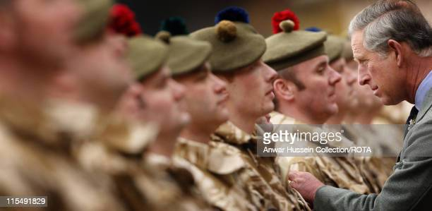 Prince Charles Prince of Wales honours Territorial Army soldiers who served in Iraq during a presentation ceremony at his private Scottish home...