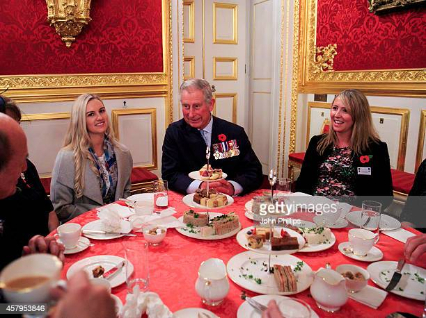 Prince Charles Prince of Wales hosts an afternoon tea reception for members of the Victoria Cross and George Cross Association at St James Palace on...