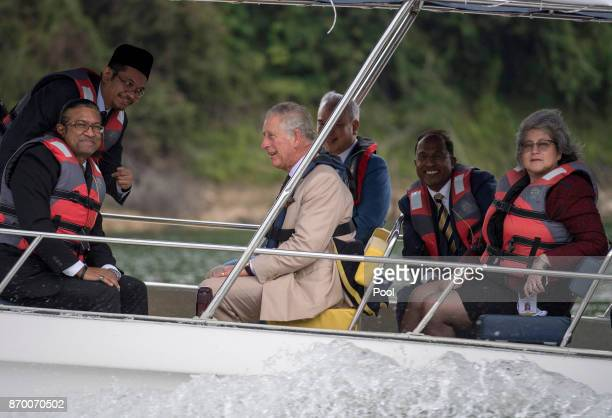 Prince Charles Prince of Wales in a boat during a visit to Temenggor Lake where he heard about the area's biodiversity and wildlife as well as the...