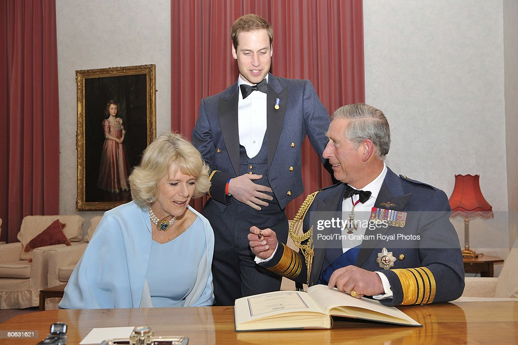 Prince Charles, Prince of Wales in his role as Air Chief Marshal, Camilla, Duchess of Cornwall and Prince William sign the visitor's book after attending the Sunset Ceremony and gala dinner to celebrate the 90th Anniversary of the Royal Air Force at RAF Cranwell, Sleaford on April 10, 2008 in Lincolnshire, England.
