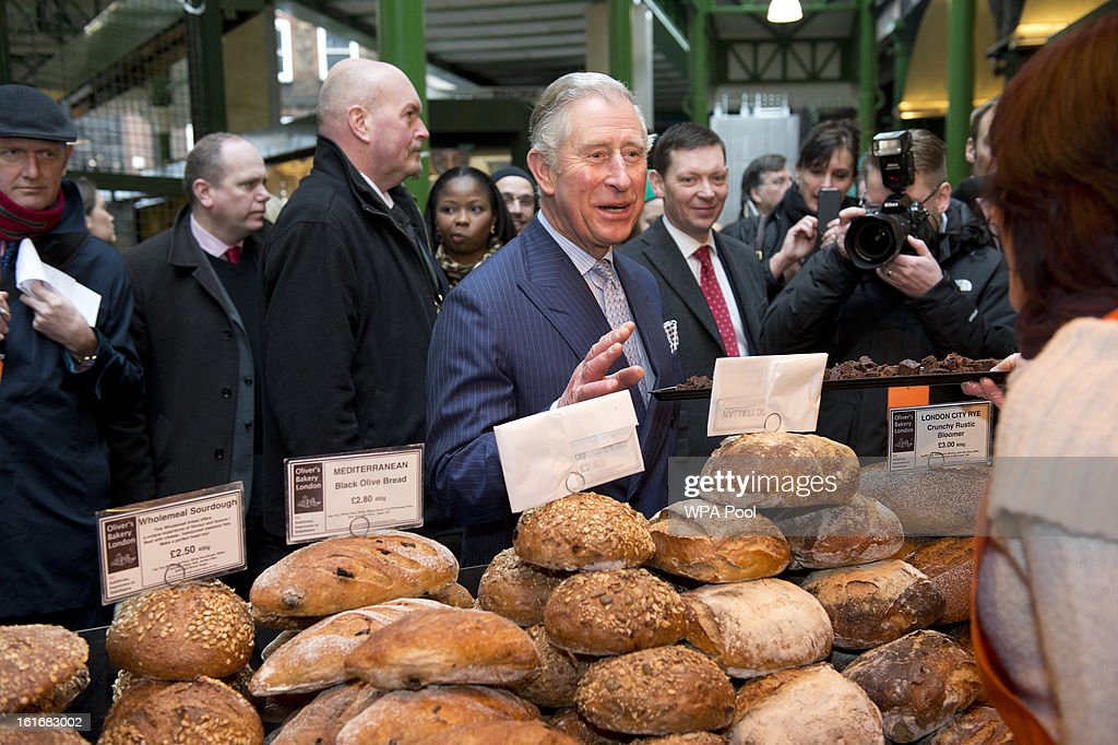 Prince Charles, Prince of Wales inspects some loaves of bread during a visit to Borough Market on February 13, 2013 in London, England.