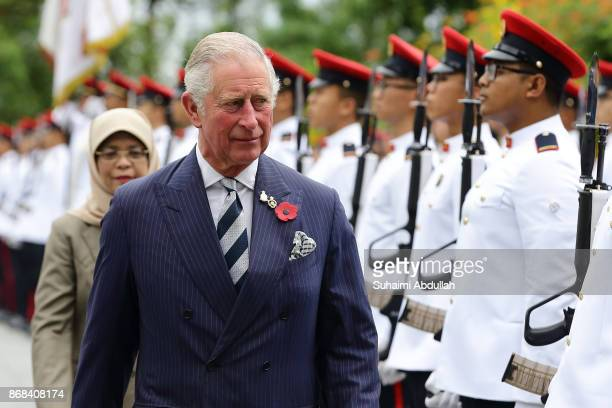 Prince Charles Prince of Wales inspects the guard of honour accompanied by Singapore President Halimah Yacob during the welcome ceremony at the...