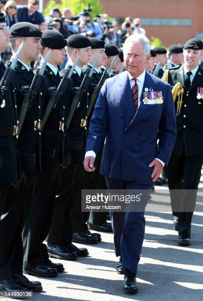 Prince Charles Prince of Wales inspects the Guard of Honour during a welcome ceremony at Canadian Forces Base Gagetown on day 1 of an official...
