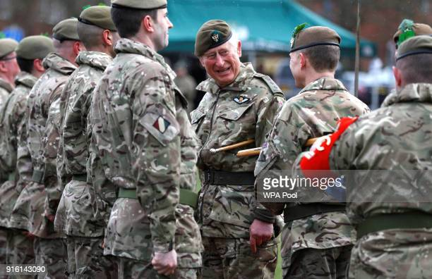 Prince Charles Prince of Wales inspects the troops as he visits 1st Battalion The Mercian Regiment to mark ten years as ColonelinChief and forty...