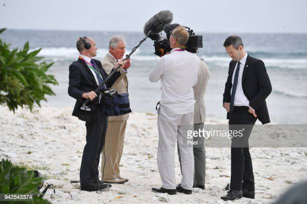 Prince Charles Prince of Wales is being interviewed by a documentary crew before a roundtable meeting discussing coral resilience on Lady Elliot...