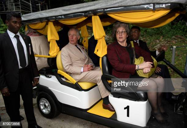 Prince Charles Prince of Wales is driven in a golf buggy during a visit to Temenggor Lake where he heard about the area's biodiversity and wildlife...