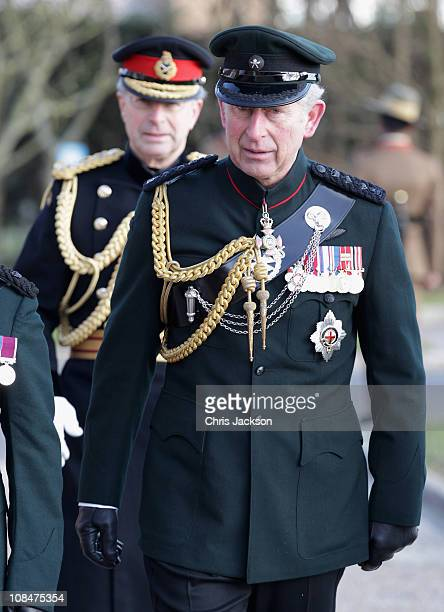 Prince Charles Prince of Wales is followed by Sir David Richards as he prepares to present Afghanistan Service Medals to Gurkas at Sir John Moore...
