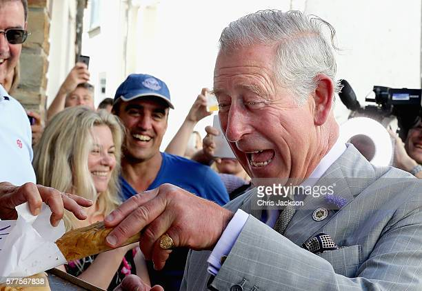 Prince Charles Prince of Wales is given a Cornish Pasty as he visits Nicki's Bakery on July 19 2016 in Port Isaac England
