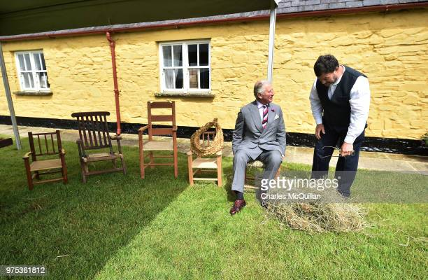 Prince Charles Prince of Wales is given a demonstration in the art of wicker chair making on his visit to Muckross House on June 15 2018 in Killarney...