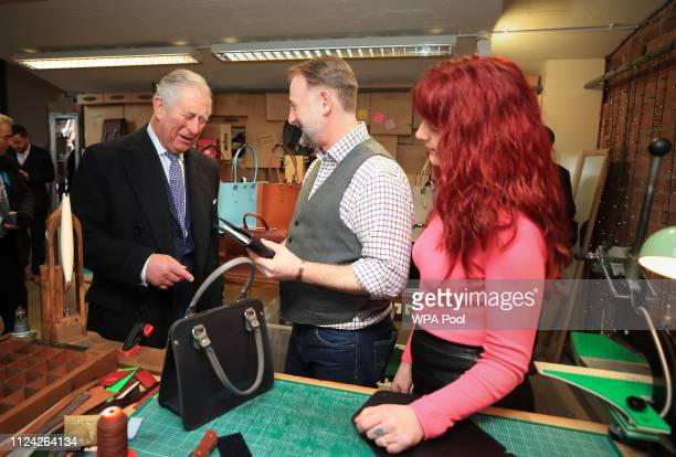 Prince Charles Prince of Wales is given the present of an organiser and a handbag for Camilla Duchess of Cornwall by Keith and Gail Hanshaw from The...