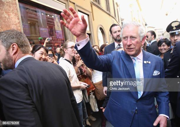 Prince Charles Prince of Wales is greeted by crowds as he leaves Palazzo Strozzi after unveiling a sculpture by Henry Moore to mark the Centenary of...