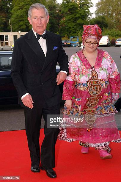 Prince Charles Prince of Wales is greeted by founder Camila Batmanghelidjh as he arrives at a Kids Company dinner on May 14 2008 in London England