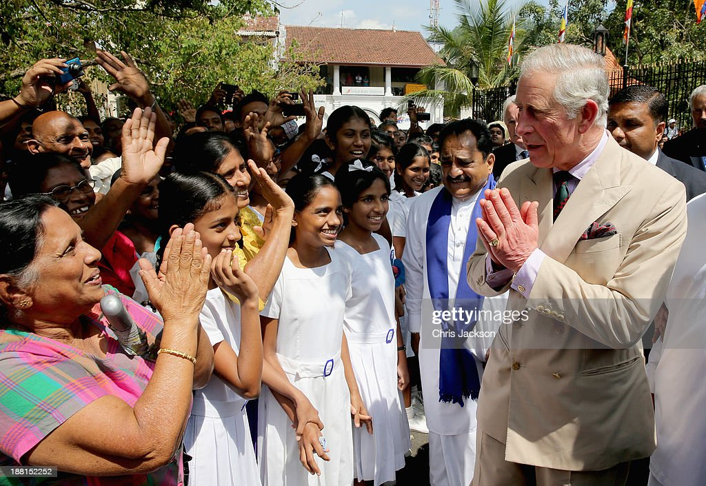 Prince Charles, Prince of Wales is greeted by large crowds as he arrives to visit the Temple of the Tooth on Day 3 of a visit to Sri Lanka on November 16, 2013 in Kandy, Sri Lanka. The Royal couple are visiting Sri Lanka in order to attend the 2013 Commonwealth Heads of Government Meeting.Prince Charles, representing the Queen will open the meeting.