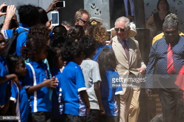 Prince Charles Prince of Wales is greeted by local students as he departs the BukuLarrnggay Centre on April 9 2018 in Gove Australia The Prince of...