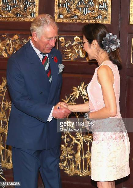 Prince Charles Prince of Wales is greeted by Malaysian actress Michelle Yeoh as he arrives at Penang's Peranakan Mansion to attend a reception to...