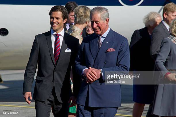 Prince Charles Prince of Wales is greeted by Prince Carl Philip of Sweden as he arrives at Arlanda Airport on the first day of a state visit to...