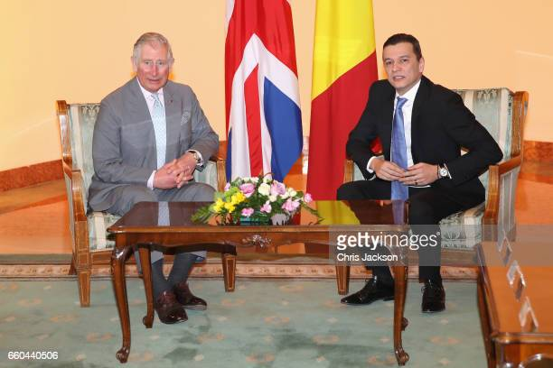 Prince Charles Prince of Wales is greeted by Romanian Prime Minister Sorin Grindenau as he visits the Palatul Victoria the office of the Prime...