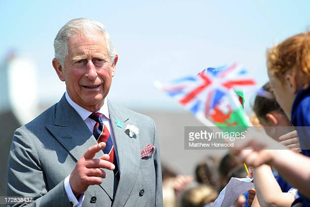 Prince Charles Prince of Wales is greeted by wellwishers during a visit to the Prince Of Wales Inn Ton Kenfig on July 5 2013 in Bridgend Wales