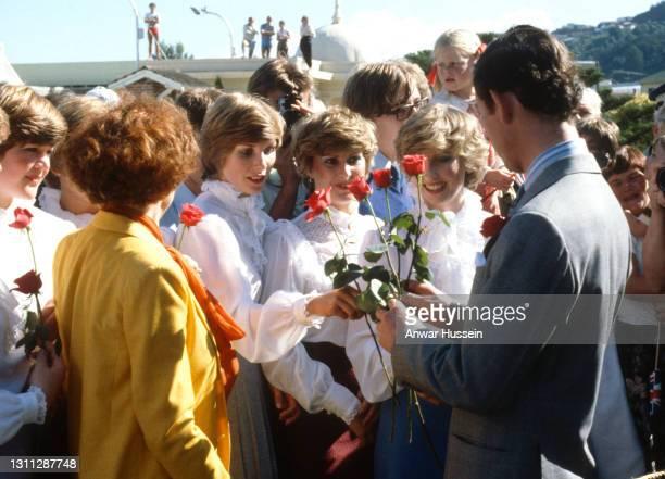 Prince Charles, Prince of Wales is handed red roses from Princess Diana look-alikes Gina Kremer, Joanne Dean and Belinda Wood ahead of his wedding,...
