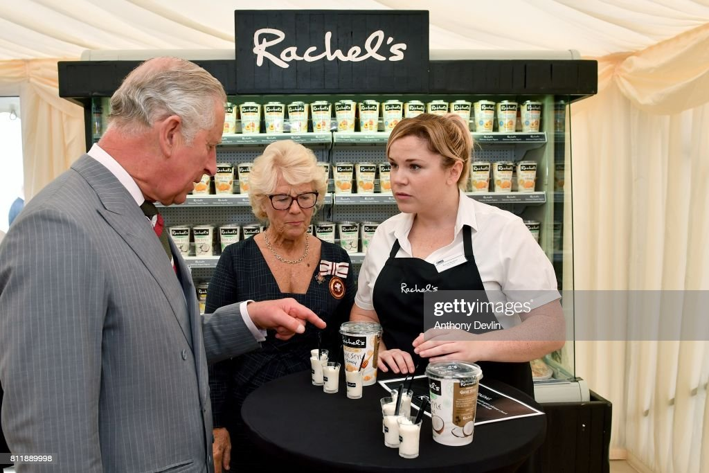 Prince Charles, Prince of Wales is joined by Rachel Rowlands (C) founder of Rachel's Organic as he speaks with employee Rachel Brittain (R) and samples the produce on a tour of the firms new extension during The Prince of Wales' annual Summer visit to Wales at Rachel's Organic on July 10, 2017 in Aberystwyth, Wales. Rachel's was Britain's first organic dairy and was a pioneer of branded organic produce. The company supplies a range of organic products, all made simply, using the highest quality ingredients, with no artificial colours, flavourings or preservatives.