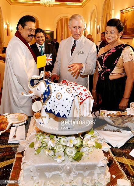 Prince Charles, Prince of Wales is presented with a birthday cake topped with three Elephants, by the President of Sri Lanka Mahinda Rajapaksa and...