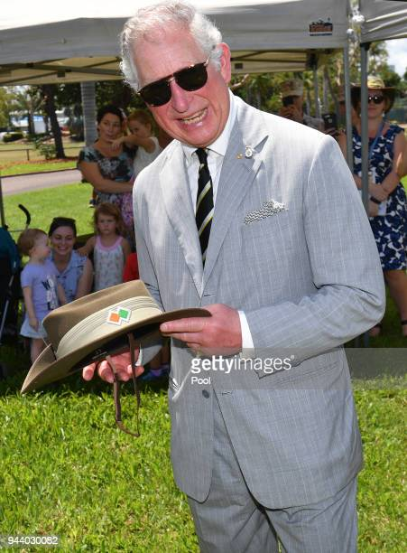Prince Charles Prince of Wales is presented with a slouch hat during his visit to the Larrakeyah Defence Precinct on April 10 2018 in Darwin...