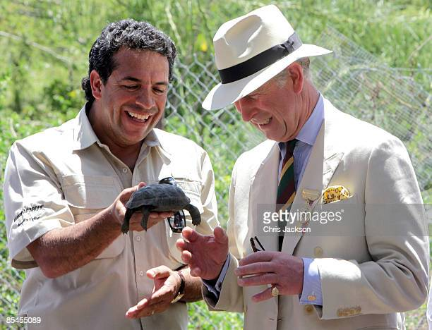 Prince Charles Prince of Wales is presented with a tortoise whom he named William during a tour of the Darwin Research Station on Santa Cruz Island...