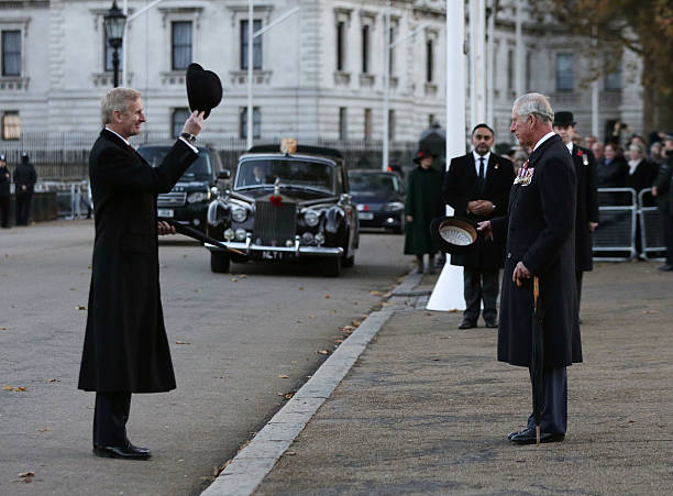 Prince Charles Prince of Wales is saluted by Major General Richard Standford after laying a wreath at the Guard's Memorial for the Welsh Guards'...