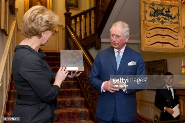 Prince Charles Prince of Wales is seen alongside the Executive Director of the Crop Trust Marie Haga as he hosts a Crop Trust reception at Clarence...