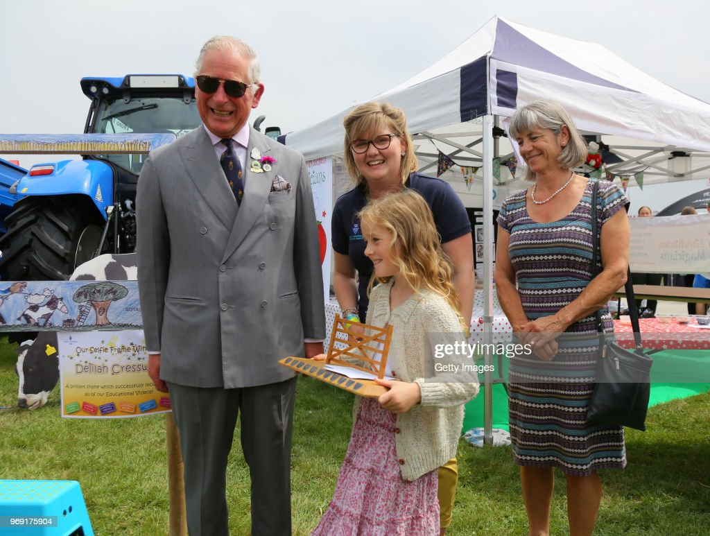 Prince Charles, Prince of Wales (Patron of the Royal Cornwall Agricultural Association) is seen with Delilah Cresswell, winner of the selfie frame competition, that will link 6 of the show's educational videos together, as he attends the Royal Cornwall Show on June 7, 2018 in Wadebridge, England.