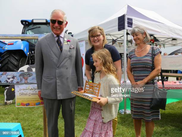 Prince Charles Prince of Wales is seen with Delilah Cresswell winner of the selfie frame competition that will link 6 of the show's educational...