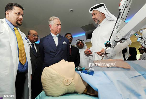 Prince Charles Prince of Wales is shown a dummy for use in practicing micro robotic Heart surgery by Professor Abdullah Al Ansari during a tour of...